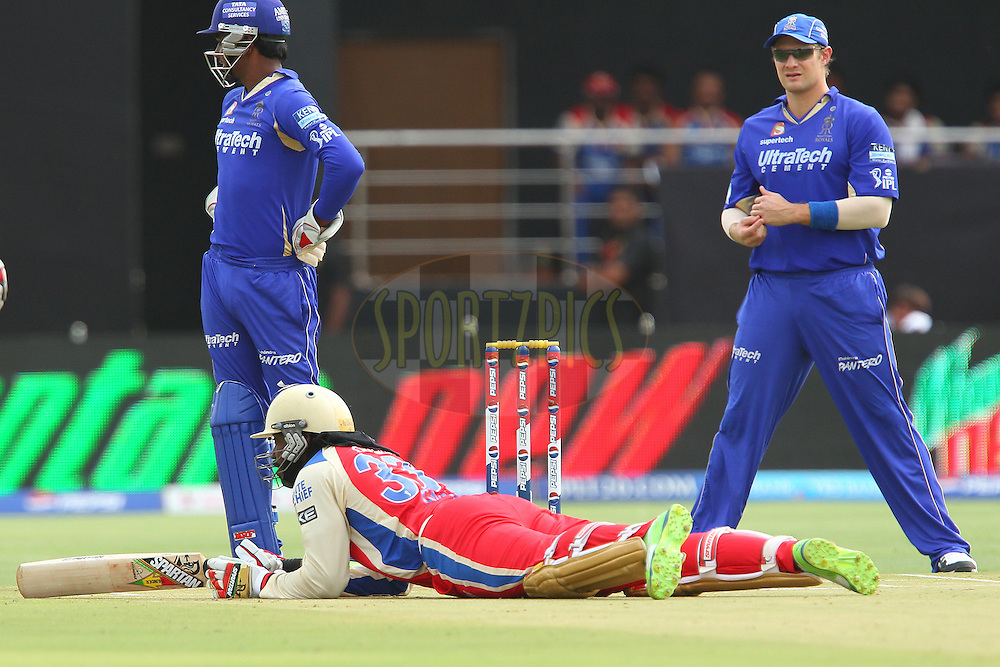 Chris Gayle slips whilst batting during match 40 of the Pepsi Indian Premier League ( IPL) 2013  between The Rajasthan Royals and the Royal Challengers Bangalore held at the Sawai Mansingh Stadium in Jaipur on the 29th April 2013..Photo by Ron Gaunt-IPL-SPORTZPICS ..Use of this image is subject to the terms and conditions as outlined by the BCCI. These terms can be found by following this link:..http://www.sportzpics.co.za/image/I0000SoRagM2cIEc