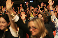 27 August 2007: People raise their hands when Democratic presidential hopeful John Edwards asks who has been affected by cancer at the LIVESTRONG Presidential Cancer Forum in Cedar Rapids, Iowa on August 27, 2007.