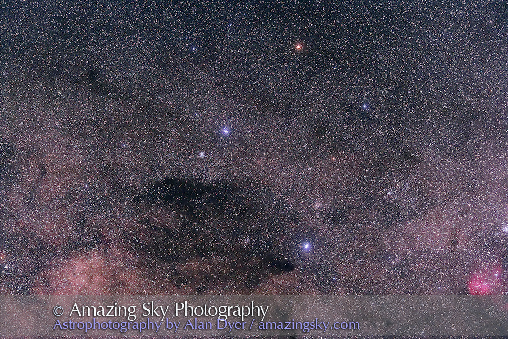 Southern Cross (Crux) and Coal Sask, field oriented equatorially, with Hutech-modified Canon 5D camera with 135mm f/2 Canon L lens at f/4 for 6 minutes each at ISO400. Stack of 4 exposures, averaged stacked. Taken from Queensland, Australia, June 2006.