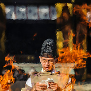 JANUARY 14, 2016 - A shinto priest reads blessings during the Sagicho fire ceremony at Wakamiya Hachiman-sha shrine in Nagoya, Japan.