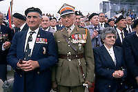 June 5-6, 1994, France --- Two WWII veteran officers solemnly watch the memorial services at the 50th Anniversary celebration of the D-Day invasion of Omaha Beach in Normandy, France. | Location: Near St.-Laurent-sur-Mer, France.  --- Image by © Owen Franken/Corbis