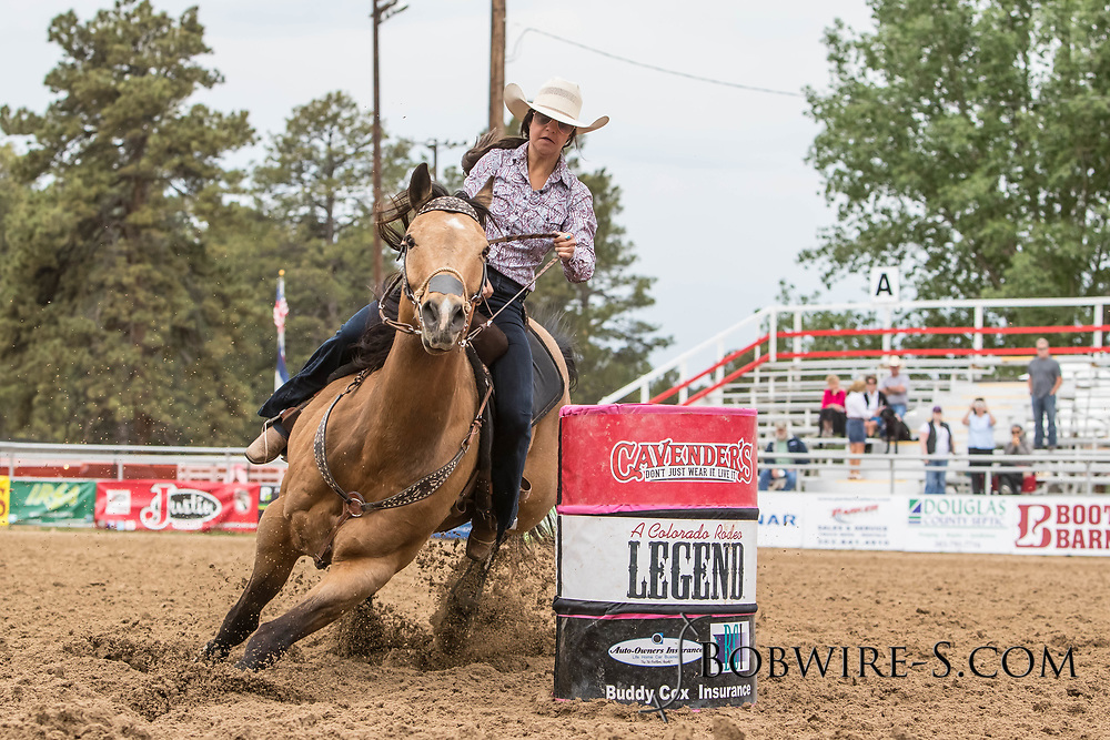 Rachel Jackson makes her barrel racing run during slack at the Elizabeth Stampede on Sunday, June 3, 2018.