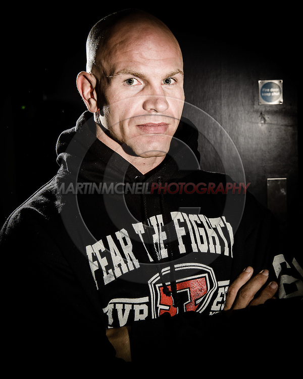 "MANCHESTER, ENGLAND, NOVEMBER 24, 2013: Ryan Jimmo poses for a portrait ahead of ""UFC Fight Night 30: Machida vs. Munoz"" inside the Crowne Plaza Hotel in Manchester, England (Martin McNeil for ESPN)"