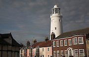 Quaint cottages and the famous lighthouse in the centre of the small seaside resort of Southwold, Suffolk, England, UK