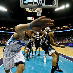 February 7, 2011; New Orleans, LA, USA; New Orleans Hornets shooting guard Marco Belinelli (8) falls into the padding under the basket during the fourth quarter against the Minnesota Timberwolves at the New Orleans Arena. The Timberwolves defeated the Hornets 104-92.  Mandatory Credit: Derick E. Hingle