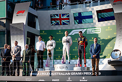 March 17, 2019 - Albert Park, VIC, U.S. - ALBERT PARK, VIC - MARCH 17: L-R Second place Mercedes-AMG Petronas Motorsport driver Lewis Hamilton (44), winner Mercedes-AMG Petronas Motorsport driver Valtteri Bottas (77) and Aston Martin Red Bull Racing driver Max Verstappen (33) on the podium at The Australian Formula One Grand Prix on March 17, 2019, at The Melbourne Grand Prix Circuit in Albert Park, Australia. (Photo by Speed Media/Icon Sportswire) (Credit Image: © Steven Markham/Icon SMI via ZUMA Press)