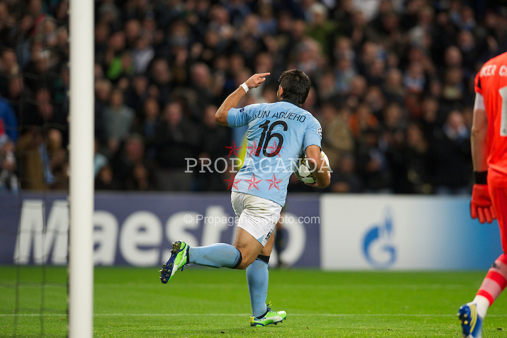 MANCHESTER, ENGLAND - Wednesday, November 21, 2012: Manchester City's Sergio Aguero celebrates scoring an equalising goal against Real Madird CF from the penalty spot during the UEFA Champions League Group D match at the City of Manchester Stadium. (Pic by David Rawcliffe/Propaganda)
