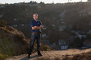 Oscar Romo stands in front of Tijuana's Los Laureles Canyon, where he founded his non-profit, Alter Terra, in 2008. The paved-over creek at the bottom of Los Laureles flows directly north to the border with the United States and the canyon is a major source of pollution due to informal development and a lack of basic infrastructure.