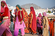 Women in colorful saris at Pushkar lake (India)
