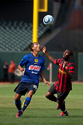 July 16, 2011; San Francisco, CA, USA;  Club America midfielder Edgar Castillo (15) wins a header from Manchester City midfielder Shaun Wright-Phillips (8) during the first half at AT&T Park.