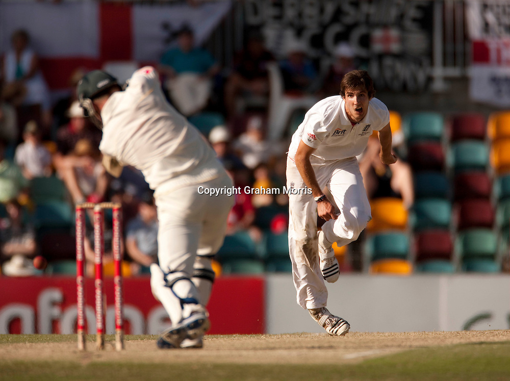 Steven Finn bowls during the first Ashes Test Match between Australia and England at the Gabba, Brisbane. Photo: Graham Morris (Tel: +44(0)20 8969 4192 Email: sales@cricketpix.com) 27/11/10
