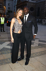 Fashion designer OZWALD BOATENG and his wife GYUNEL at a tribute to Luciano Pavarotti in aid of the British Red Cross held at The Guildhall, City of London on 6th June 2005<br />
