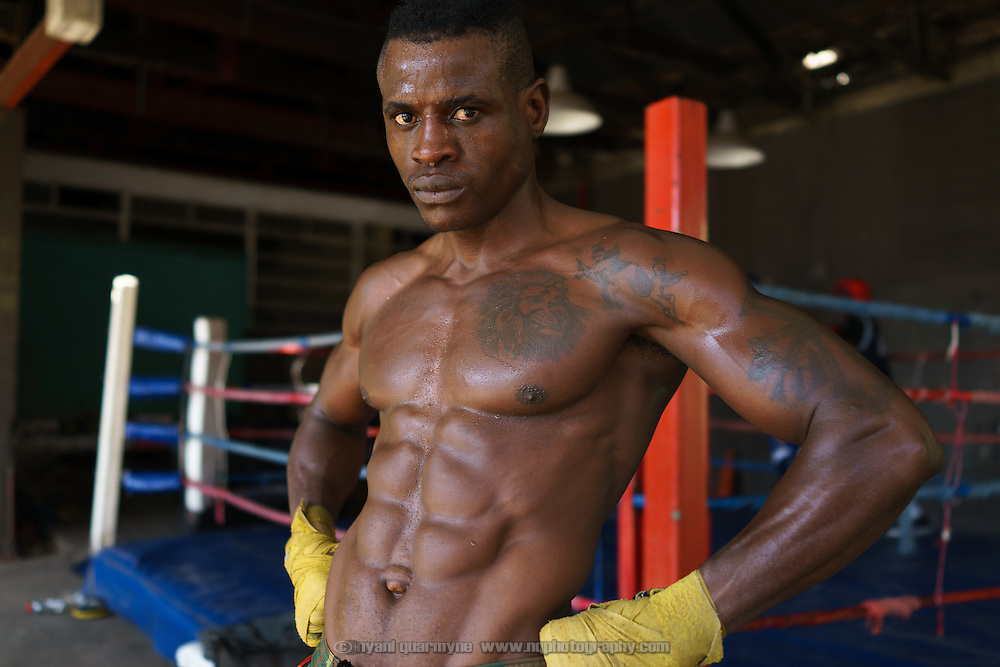Yomi Shokunbi, a Nigerian living in South Africa, at the Hillbrow Boxing Club. Currently a model and fitness trainer, he hopes to qualify for his boxing license in a few weeks time and become a professional heavyweight boxer.