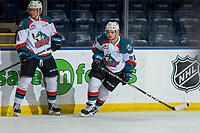 KELOWNA, CANADA - JANUARY 9: Devin Steffler #4 and Schael Higson #21 of the Kelowna Rockets warm up against the Everett Silvertips on January 9, 2019 at Prospera Place in Kelowna, British Columbia, Canada.  (Photo by Marissa Baecker/Shoot the Breeze)