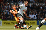 Hull City midfielder Jake Livermore tackles Derby County midfielder Craig Bryson during the Sky Bet Championship play-off first leg match between Derby County and Hull City at the iPro Stadium, Derby, England on 14 May 2016. Photo by Alan Franklin.