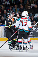 KELOWNA, CANADA - JANUARY 26: Kevin Bennett, referee gets between players of the Prince Albert Raiders at the Kelowna Rockets on January 26, 2013 at Prospera Place in Kelowna, British Columbia, Canada (Photo by Marissa Baecker/Shoot the Breeze) *** Local Caption ***