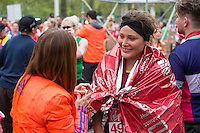 Runners and marshals in the finishing straight after finishing line on The Mall the Virgin Money London Marathon, Sunday 26th April 2015.<br /> <br /> Dillon Bryden for Virgin Money London Marathon<br /> <br /> For more information please contact Penny Dain at pennyd@london-marathon.co.uk