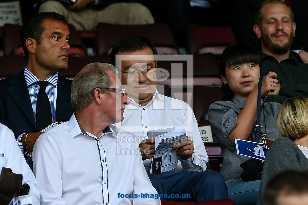 Jeff Shi, Fosun represenative on the Wolves board, (centre) takes his seat before the pre-season match at Sixfields Stadium, Northampton<br /> Picture by Andy Kearns/Focus Images Ltd 0781 864 4264<br /> 26/07/2016