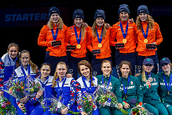 13-01-2019 NED: ISU European Short Track Championships 2019 day 3, Dordrecht<br /> Team Netherlands (top), Russia (left) and Hungary pose in the Ladies Relay medal ceremony during the ISU European Short Track Speed Skating Championships