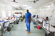 Harun Kimani (Kenian Nurse is in charge of the Orthopedic Ward) poses in the Orthopedic Ward at the EMERGENCY Surgical and Paediatric Centre in Goderich - Freetown (July 20, 2016). This Emergency Hospital is the most frequented hospital for emergency cases. Every accident from Freetown and sometimes from the outside is being brought in here. The treatment is free.<br /> <br /> The EMERGENCY project is funded by the European Commission.<br /> <br /> EMERGENCY has designed this project upon request of its local partners, WARDC and PGRMI. The project's strategy is based on a comprehensive approach involving Non State Actors and Local Authorities in order to improve the efficiency of the health sector and to establish good intersectorial practices in the field of health and education. EMERGENCY puts in place a structured system for civil society organizations, local authorities and government institutions where everyone can contribute to improving health service delivery and education standards at the WARD area. It will also deliver promotion campaigns which will address children, teachers and communities about the availability of the three national health programs (FHCI, NMCP and SFP) and about how to access basic services by informing them about their rights.