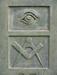 Masonic signs on gravestone: Masonic eye; square and compasses.