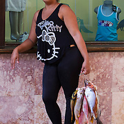 Fishing is not only a favorite pastime for Cubans but it is also an income source. A woman sells her daily catch in La Habana Vieja. Photography by Jose More
