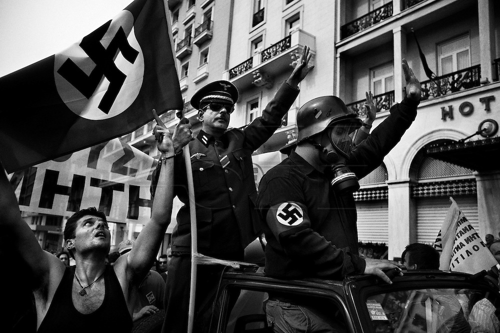Athens, Greece - Demonstrators protest against Angela Merkel dressed as Nazis during her official visit to Athens (October 9th, 2012). Greek economical crisis started in 2008. The so-called Austerity measures imposed to the country by the &ldquo;Troika&rdquo; (European Union, European Central Bank, and International Monetary Fund) to reduce its debt, were followed by a deep recession and the worsening of life conditions for millions of people. Unemployment rate grew from 8.5% in 2008 to 25% in 2012 (source: Hellenic Statistical Authority). <br /> Bruno Sim&otilde;es Castanheira