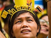 "05 DECEMBER 2015 - BANGKOK, THAILAND: A woman wears a ""long live the King"" headband in the plaza at Siriraj Hospital on the 88th birthday of Bhumibol Adulyadej, the King of Thailand. Hundreds of people crowded into the plaza hoping to catch a glimpse of the revered Monarch. The King has lived at Siriraj Hospital off and on for more than four years.     PHOTO BY JACK KURTZ"