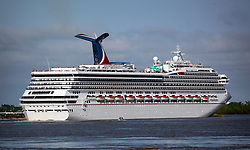 14 Apr 2013. New Orleans, Louisiana,  USA. .Carnival Cruise line's ship 'Conquest' pulls away from New Orleans on the Mississippi River as seen from the French Quarter. .Photo; Charlie Varley.