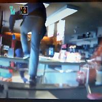 Nederland, Amsterdam , 6 april 2015.<br /> Om 13.45u vanmiddag is snackbar Orion aan de Meteorenweg in Noord overvallen door 4 jongens van 12-14 jaar.<br /> Een jongen van 12 jaar is gepakt.<br /> Op de foto: een buurtbewoner troost de eigenaar van de snackbar die nog nauwelijks van de schrik is bekomen.<br /> hij toont de camerabeelden op zijn laptop.<br /> Foto:Jean-Pierre Jans