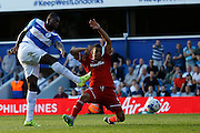 Jay Emmanuel-Thomas strikes goal wards despite Joe Ralls attempt to block during the Sky Bet Championship match between Queens Park Rangers and Cardiff City at the Loftus Road Stadium, London, England on 15 August 2015. Photo by Andy Walter.