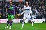 Adam Forshaw of Leeds United (4) is marked by Jack Hunt of Bristol City (32) during the EFL Sky Bet Championship match between Leeds United and Bristol City at Elland Road, Leeds, England on 24 November 2018.