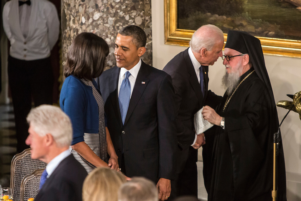 President Barack Obama talks with First Lady Michelle Obama as Vice President Joseph R. Biden talks with Archbishop Demetrios of America, who gave the benediction, at the Inaugural Luncheon in Statuary Hall at the U.S. Capitol on Monday, January 21, 2013 in Washington, DC.