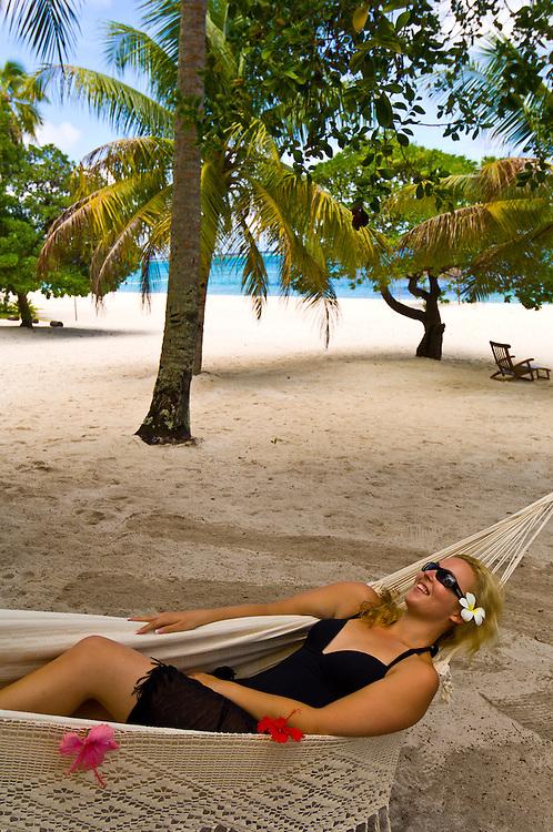 Woman on her honeymoon relaxing in a hammock, Vatulele Island Resort, Fiji Islands
