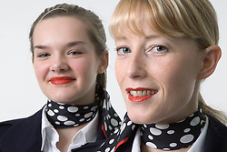 Two women; dressed as air stewardesses; who offer a mobile retail service selling essential personal products in Nottingham nightclubs and social venues,