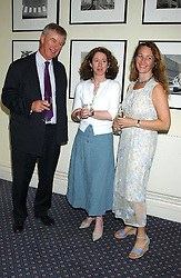 Left to right, MARK STREATFEILD, KATIE WHITE and FRANCINE BRODY at a party to celebrate the publication of 'An Act of Peace' by Ann Widdecombe at 11 Carlton House Terrace, London on 19th July 2005.<br />