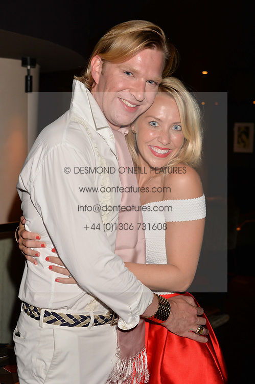 Henry Conway and Laura Hamilton at the Quaglino's Q Legends Summer Launch Party hosted by Henry Conway at Quaglino's, 16 Bury Street, London England. 18 July 2017.