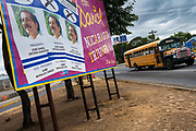 "07 JANUARY 2007 - MANAGUA, NICARAGUA: A bus passes a campaign poster for Daniel Ortega and the Sandanista party in Managua, Nicaragua. The Sandanistas won the November election and took power in January, 17 years after they were swept from power by the UNO opposition coalition headed by Violetta Chamorro. The Sandanistas ruled Nicaragua from 1979 to 1990 after they defeated the Somoza government. Their tenure was marked by advances in education and health care, but also by a war against the ""Contras"" an anti-Sandanista army organized and funded by the Reagan administration.  Photo by Jack Kurtz"