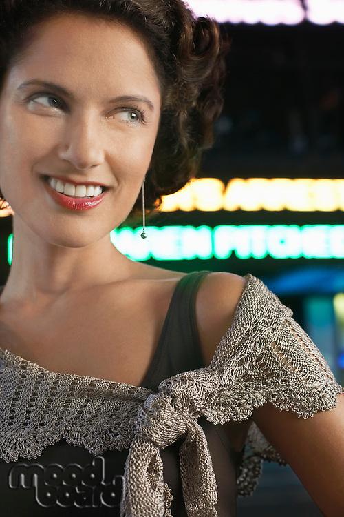 Stylish Woman on Sidewalk at night close up