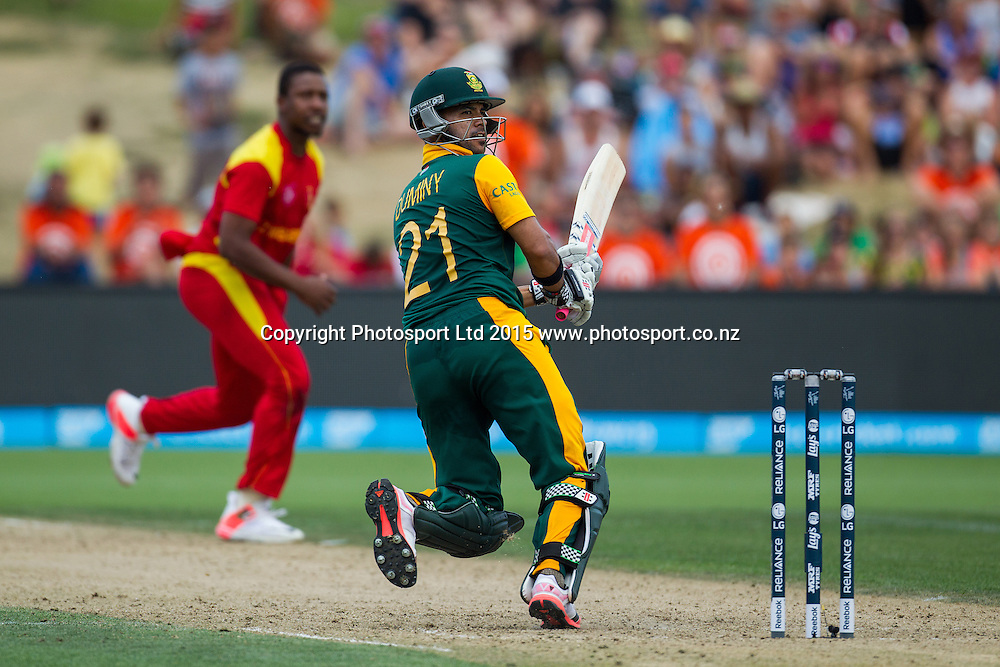South Africa's JP Duminy hits a boundary to bring up his hundred during the ICC Cricket World Cup match - South Africa v Zimbabwe at Seddon Park, Hamilton, New Zealand on Sunday 15 February 2015.  Photo:  Bruce Lim / www.photosport.co.nz