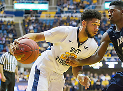 Nov 20, 2016; Morgantown, WV, USA; West Virginia Mountaineers forward Esa Ahmad (23) drives baseline during the second half against the New Hampshire Wildcats at WVU Coliseum. Mandatory Credit: Ben Queen-USA TODAY Sports