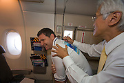 Airbus A380 first commercial flight - Singapore Airlines SQ 380 Singapore-Sydney on October 25, 2007. Singapore Airlines Chairman Chew Choon Seng signing a passenger's t-shirt.