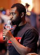 New York Jets cornerback Darrelle Revis asks a question at the Super Bowl XLV Halftime Show press conference featuring The Black Eyed Peas (held during the week of NFL Super Bowl XLV between the Pittsburgh Steelers and the Green Bay Packers) on Thursday, February 3, 2011 in Dallas, Texas. ©Paul Anthony Spinelli
