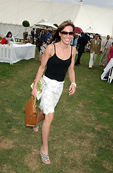 TARA PALMER-TOMKINSON at the 2004 Cartier International polo day at Guards Polo Club, Windsor Great Park, Berkshire on 25th July 2004.