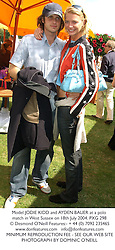 Model JODIE KIDD and AYDEN BUTLER at a polo match in West Sussex on 18th July 2004.PXG 298