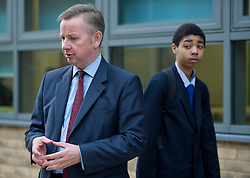 © Licensed to London News Pictures. 17/09/2012. London, UK.  A student looking at Secretary of State for Education Michael Gove during a visit to Burlington Danes Academy in West London with Deputy Prime Minister Nick Clegg on September 17, 2012. The education secretary has announced plans to launch a non-tiered new exam system that will replace GCSEs after the next general election in 2015. Photo credit : Ben Cawthra/LNP