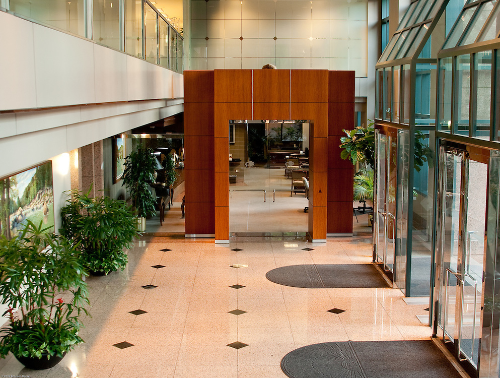 Entry portal to bank is the focal point in office building lobby in Austin.