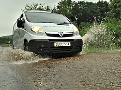 © Licensed to London News Pictures. 06/072012. Stone Staffordshire, UK. Traffic struggling through deep water following heavy rain in Stone, Staffordshire on July 6, 2012. Heavy rain, has caused chaos and localised flooding across many part of Staffordshire today. Photo credit : Rob Leyland/LNP