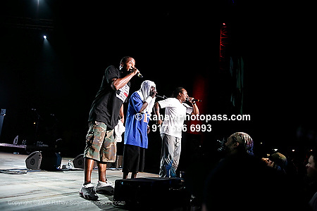 A Tribe called Quest with .Q - Tip (khaki green camouflage pants ), .Phife Dawg (towel on head and light blue shirt) and Jarobi White(white t-shirt)  performing at Nikon at Jones Beach Amphitheater for 'Rock The Bells' 2008 on August 3, 2008. .