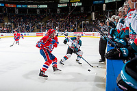 KELOWNA, CANADA - JANUARY 10: Riley McKay #27 of the Spokane Chiefs looks to check Gordie Ballhorn #4 of the Kelowna Rockets as he passes the puck up the ice during first period on January 10, 2017 at Prospera Place in Kelowna, British Columbia, Canada.  (Photo by Marissa Baecker/Shoot the Breeze)  *** Local Caption ***